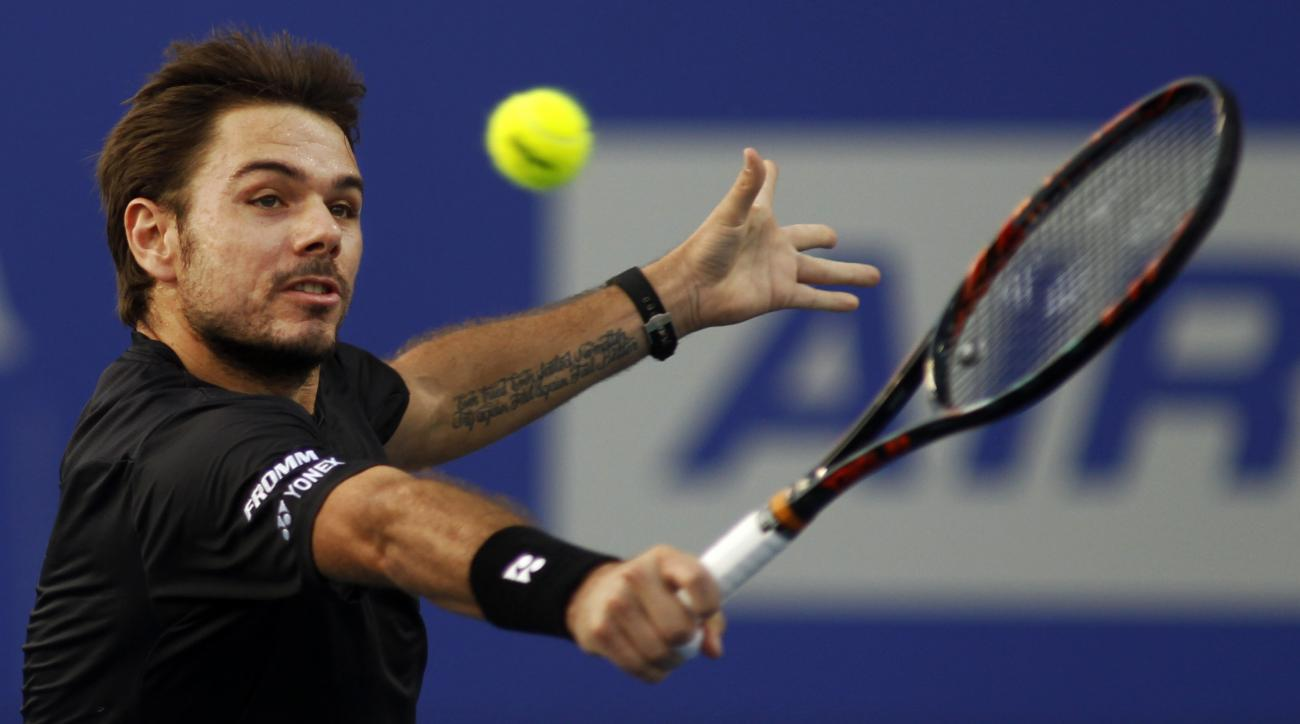 Switzerland's Stan Wawrinka plays a shot against  France's Benoit Paire during the first semi final mach of Chennai Open tennis tournament in Chennai, India, Saturday, Jan. 9, 2016. Wawrinka beat Paire in straight sets 6-3,6-4. (AP Photo/Arun Sankar K)
