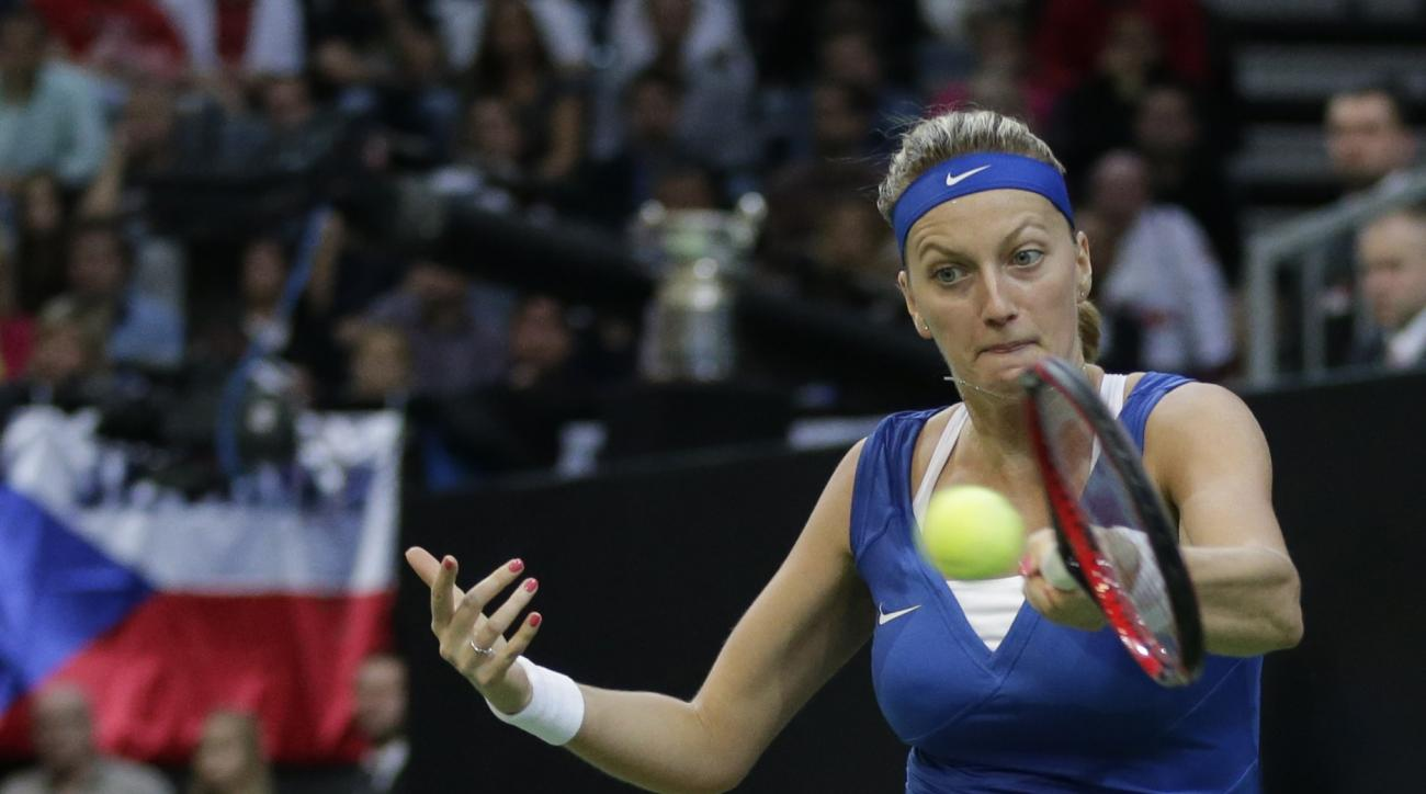 Czech Republic's Petra Kvitova returns a ball to Russia's Maria Sharapova during their Fed Cup tennis final match between Czech Republic and Russia in Prague, Czech Republic, Sunday, Nov. 15, 2015. (AP Photo/Petr David Josek)