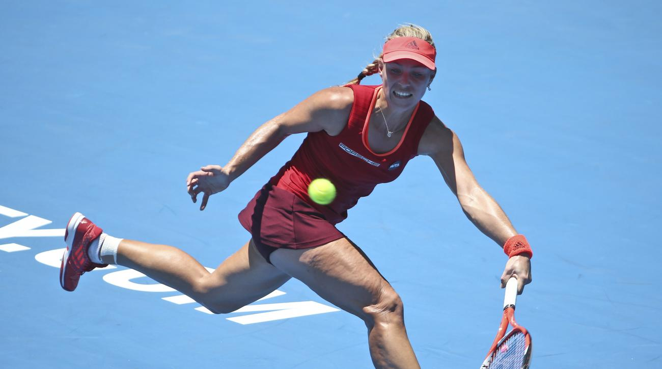 Angellque Kerber of Germany prepares to play a shot in her match against Elina Svitolina of Ukraine at the Sydney International Tennis tournament in Sydney Monday, Jan. 11, 2016. (AP Photo/Rob Griffith)