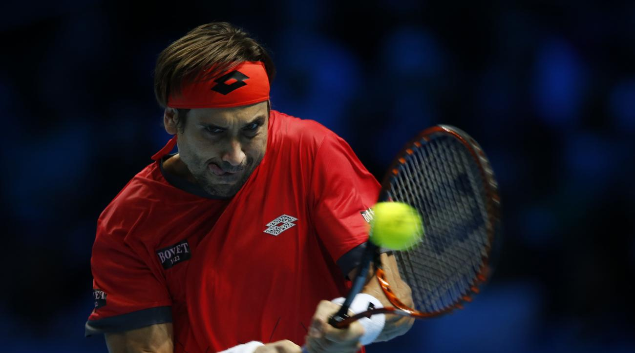 David Ferrer of Spain plays a return to Rafael Nadal of Spain during their singles tennis match at the ATP World Tour Finals at the O2 Arena in London, Friday, Nov. 20, 2015. (AP Photo/Alastair Grant)