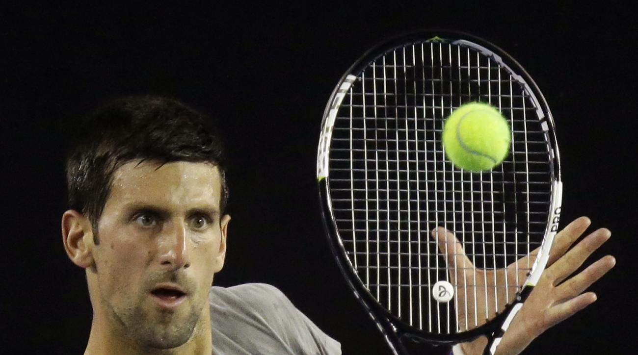 Serbia's Novak Djokovic makes a backhand return during a practice session on Rod Laver Arena ahead of the Australian Open tennis championships in Melbourne, Australia, Thursday, Jan. 14, 2016.(AP Photo/Mark Baker)