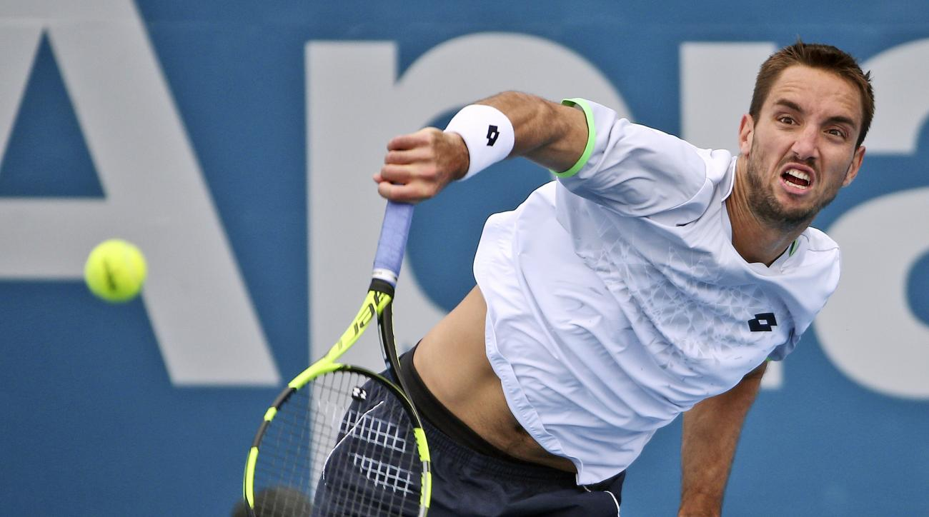 Viktor Troicki of Serbia serves in his quarterfinal match against Nicolas Mahut of France during the Sydney International Tennis tournament in Sydney Friday, Jan. 15, 2016.(AP Photo/Rob Griffith)
