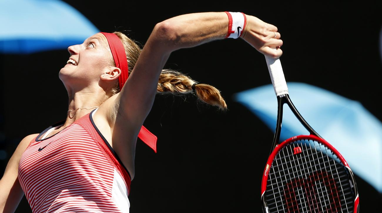 Petra Kvitova of the Czech Republic serves to Luksika Kumkhum of Thailand during their first round match at the Australian Open tennis championships in Melbourne, Australia, Monday, Jan. 18, 2016.(AP Photo/Vincent Thian)