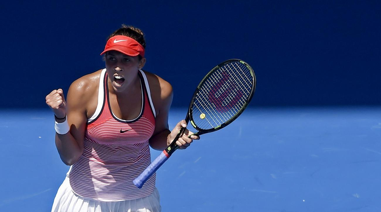 Madison Keys of the United States celebrates after winning  point against Zarina Diyas of Kazakhstan during their first round match at the Australian Open tennis championships in Melbourne, Australia, Tuesday, Jan. 19, 2016.(AP Photo/Andrew Brownbill)