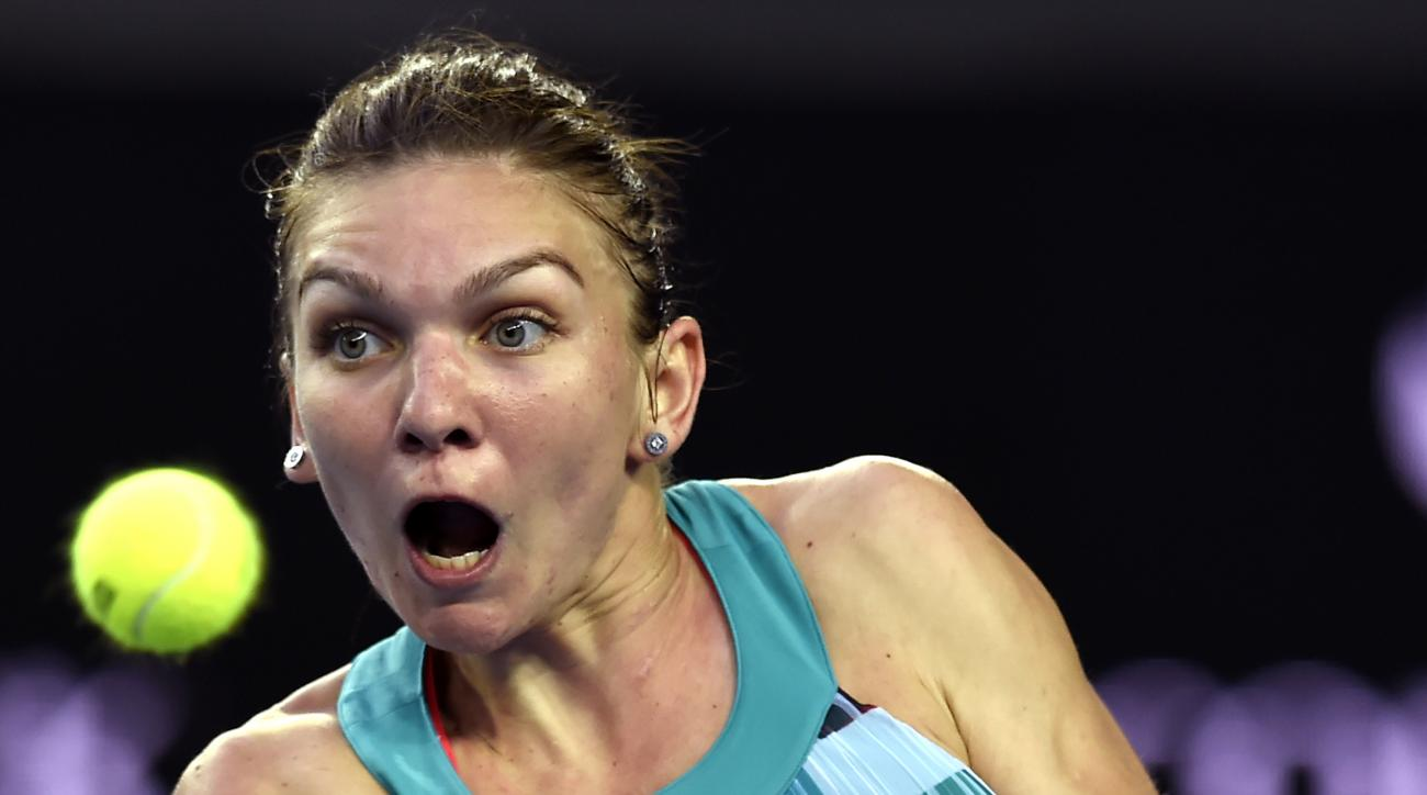 Simona Halep of Romania  makes a backhand return during her first round loss to Zhang Shuai of China at the Australian Open tennis championships in Melbourne, Australia, Tuesday, Jan. 19, 2016.(AP Photo/Andrew Brownbill)