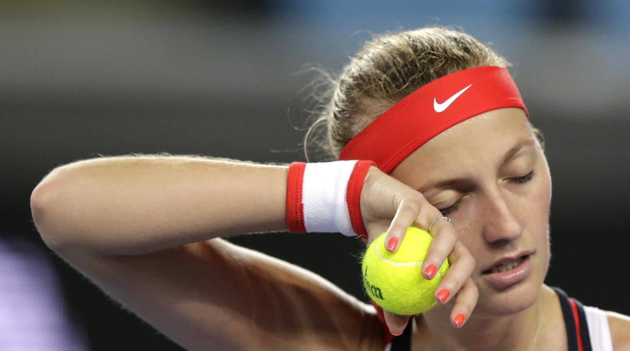 Petra Kvitova of the Czech Republic wipes sweat from her face during her second round loss to Daria Gavrilova of Australia at the Australian Open tennis championships in Melbourne, Australia, Wednesday, Jan. 20, 2016.(AP Photo/Aaron Favila)