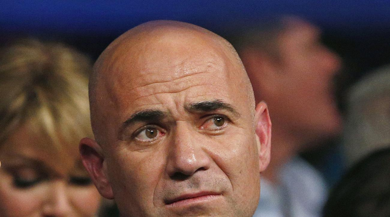 "FILE - In this May 2, 2015, file photo, Andre Agassi is shown in the crowd before the world welterweight championship bout between Floyd Mayweather Jr., and Manny Pacquiao, in Las Vegas. Andre Agassi says match-fixing in tennis ""never even made my radar"""