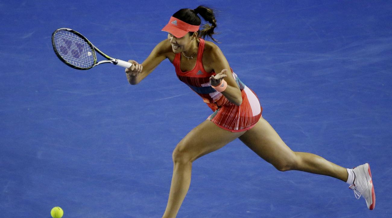 Ana Ivanovic of Serbia hits a forehand return to Anastasija Sevastova of Latvia during their second round match at the Australian Open tennis championships in Melbourne, Australia, Thursday, Jan. 21, 2016.(AP Photo/Aaron Favila)