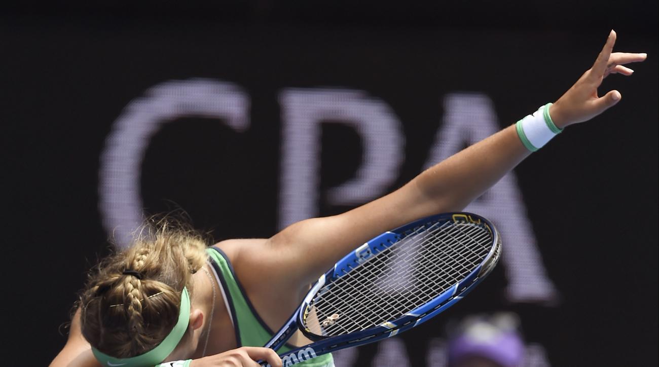 Victoria Azarenka of Belarus celebrates after defeating Danka Kovinic of Montenegro during their second round match at the Australian Open tennis championships in Melbourne, Australia, Thursday, Jan. 21, 2016.(AP Photo/Andrew Brownbill)