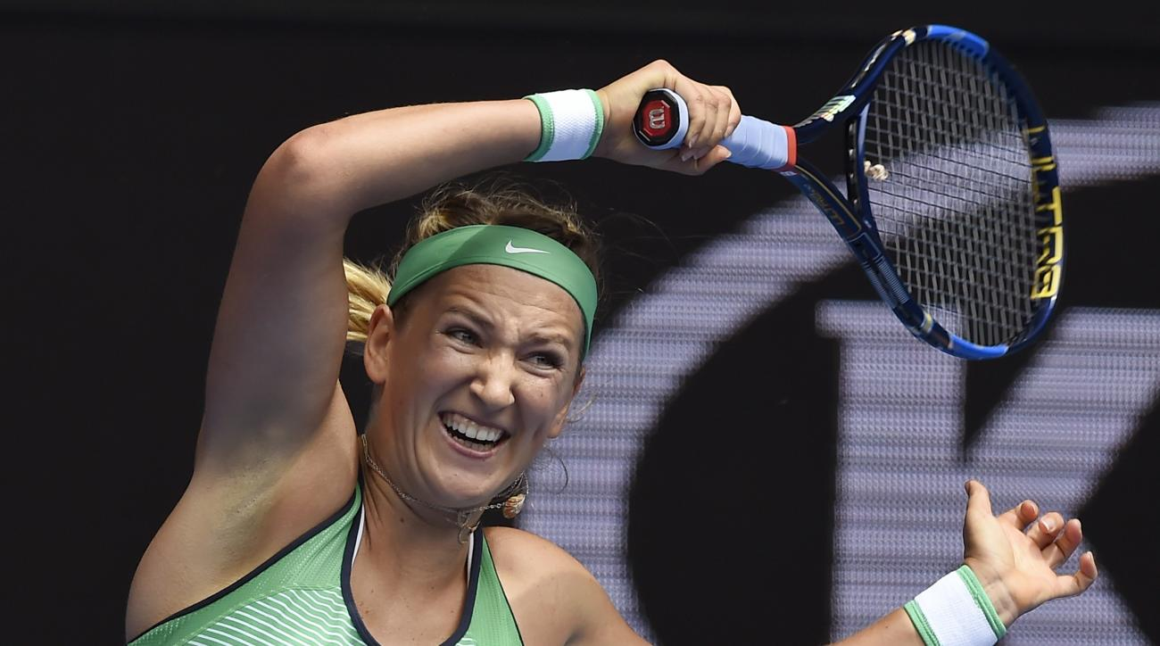 Victoria Azarenka of Belarus hits a forehand return to Danka Kovinic of Montenegro during their second round match at the Australian Open tennis championships in Melbourne, Australia, Thursday, Jan. 21, 2016.(AP Photo/Andrew Brownbill)
