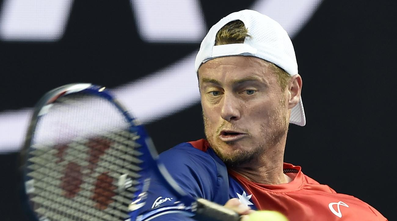 Lleyton Hewitt of Australia makes a forehand return to David Ferrer of Spain during their second round match at the Australian Open tennis championships in Melbourne, Australia, Thursday, Jan. 21, 2016.(AP Photo/Andrew Brownbill)