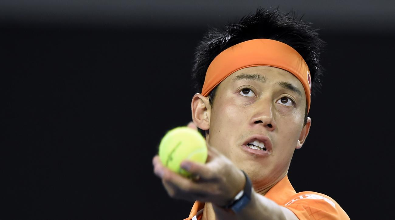 Kei Nishikori of Japan serves to Guillermo Garcia-Lopez of Spain during their third round match at the Australian Open tennis championships in Melbourne, Australia, Friday, Jan. 22, 2016.(AP Photo/Andrew Brownbill)
