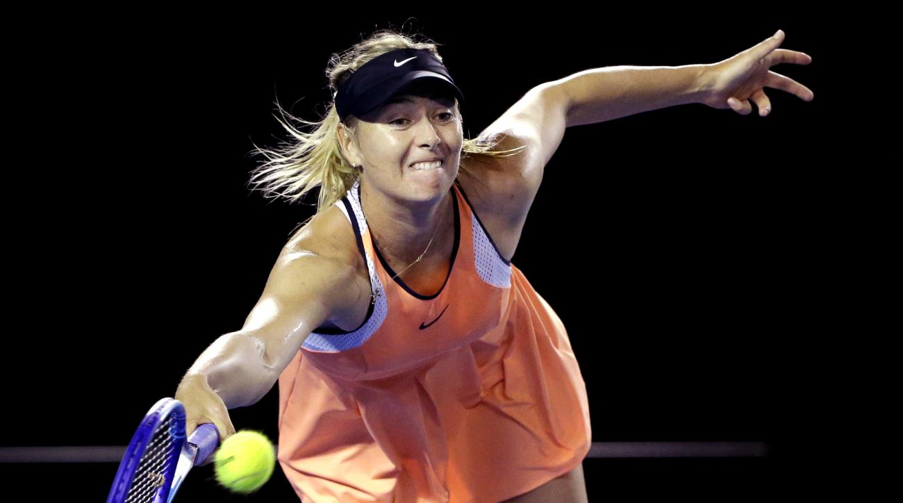 Maria Sharapova of Russia hits a forehand return to Lauren Davis of the United States during their third round match at the Australian Open tennis championships in Melbourne, Australia, Friday, Jan. 22, 2016.(AP Photo/Aaron Favila)