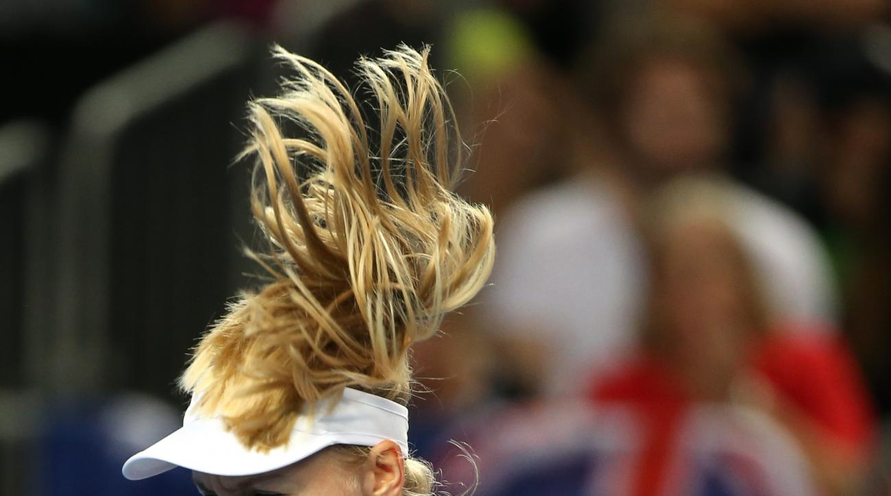Daria Gavrilova of Australia celebrates during her third round match against Kristina Mladenovic of France at the Australian Open tennis championships in Melbourne, Australia, Friday, Jan. 22, 2016.(AP Photo/Rick Rycroft)