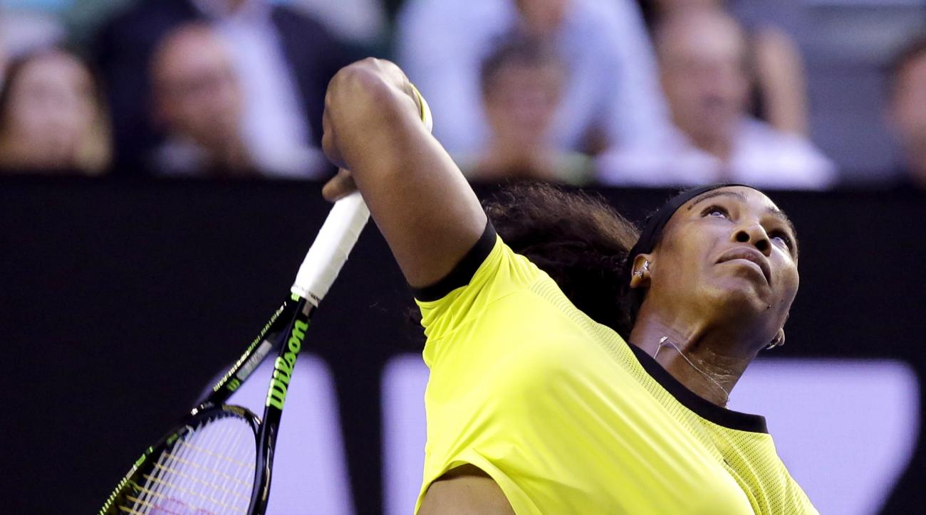Serena Williams of the United States serves to Daria Kasatkina of Russia during their third round match at the Australian Open tennis championships in Melbourne, Australia, Friday, Jan. 22, 2016.(AP Photo/Aaron Favila)