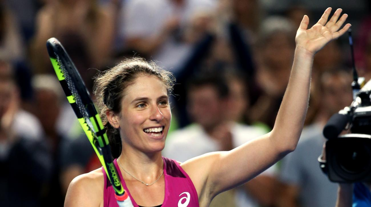 Johanna Konta of Britain celebrates after defeating Denisa Allertova of the Czech Republic in their third round match at the Australian Open tennis championships in Melbourne, Australia, Saturday, Jan. 23, 2016.(AP Photo/Rick Rycroft)