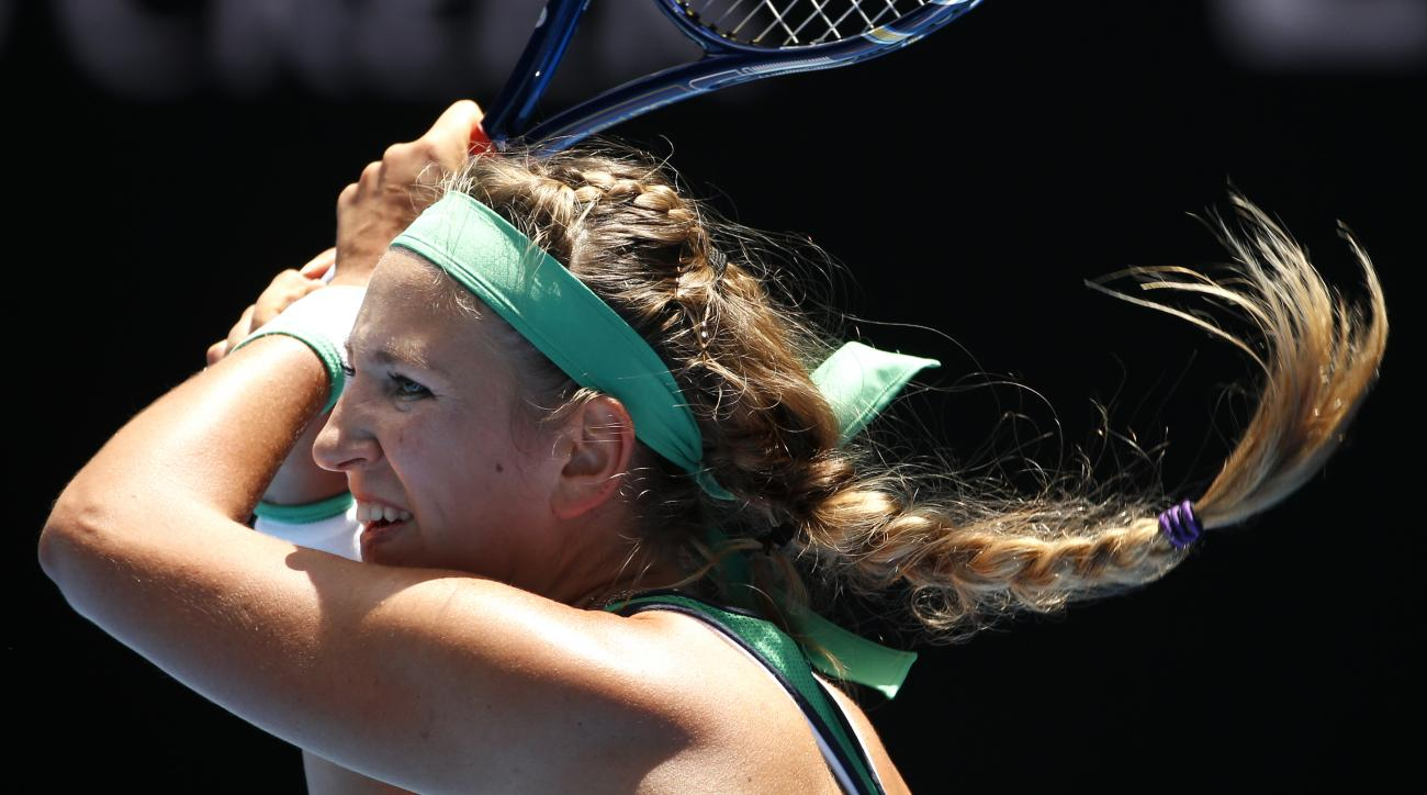 Victoria Azarenka of Belarus hits a backhand return to Naomi Osaka of Japan during their third round match at the Australian Open tennis championships in Melbourne, Australia, Saturday, Jan. 23, 2016.(AP Photo/Vincent Thian)