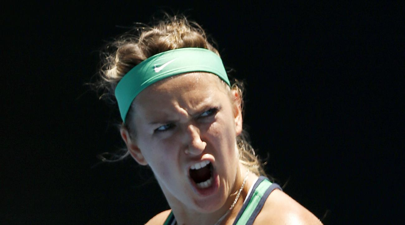 Victoria Azarenka of Belarus celebrates after defeating Naomi Osaka of Japan during their third round match at the Australian Open tennis championships in Melbourne, Australia, Saturday, Jan. 23, 2016.(AP Photo/Vincent Thian)