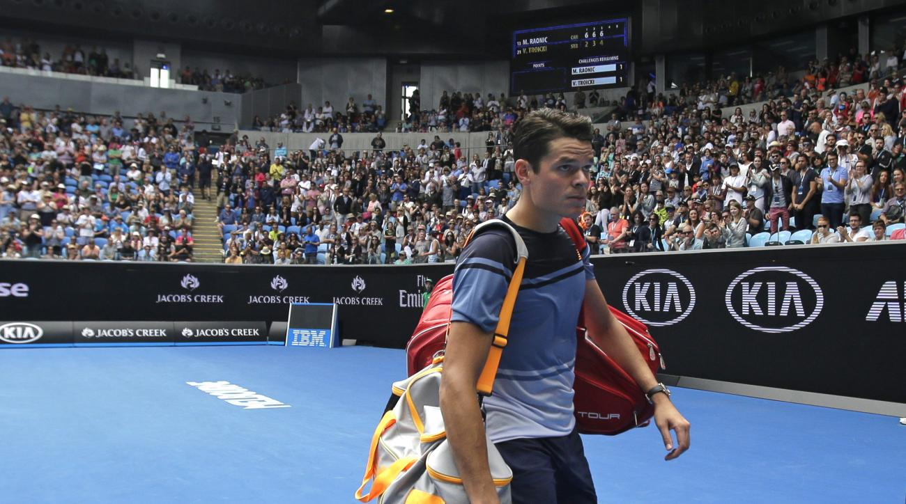 Milos Raonic of Canada  walks from Margaret Court Arena following his third round win over Viktor Troicki of Serbia at the Australian Open tennis championships in Melbourne, Australia, Saturday, Jan. 23, 2016.(AP Photo/Aaron Favila)