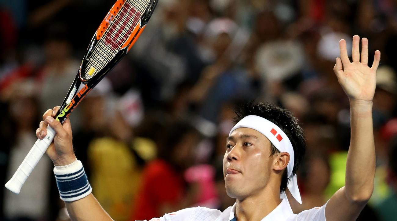 Kei Nishikori of Japan celebrates after defeating Jo-Wilfried Tsonga of France in their fourth round match at the Australian Open tennis championships in Melbourne, Australia, Sunday, Jan. 24, 2016.(AP Photo/Rick Rycroft)