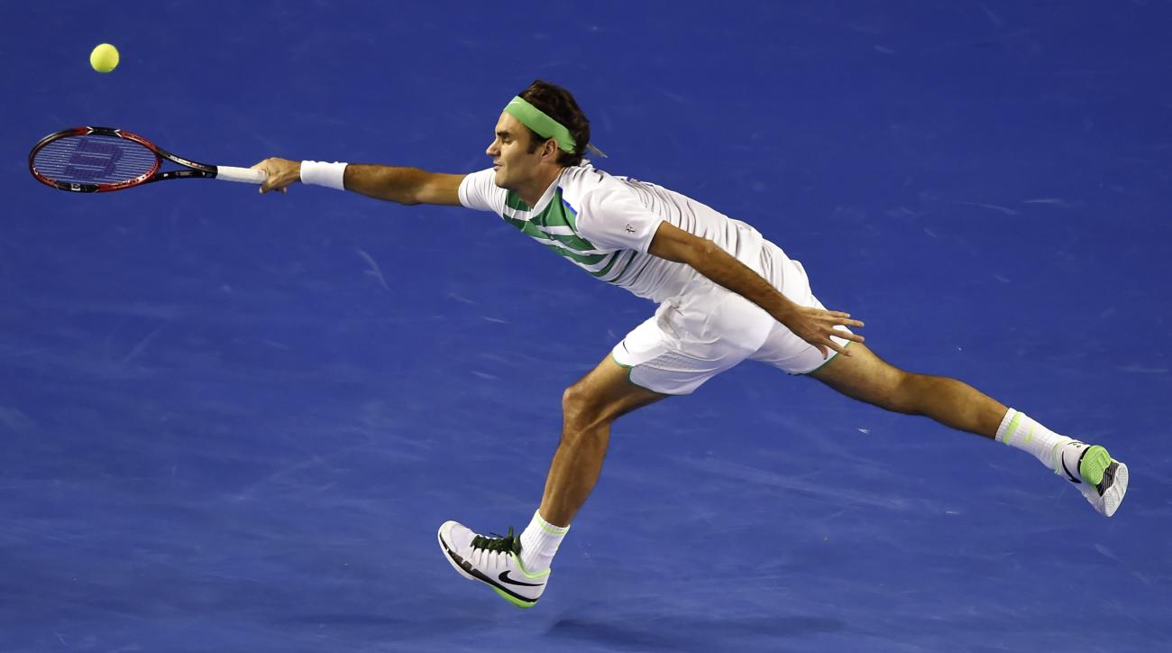Roger Federer of Switzerland reaches for a forehand return to David Goffin of Belgium during their fourth round match at the Australian Open tennis championships in Melbourne, Australia, Sunday, Jan. 24, 2016.(AP Photo/Andrew Brownbill)