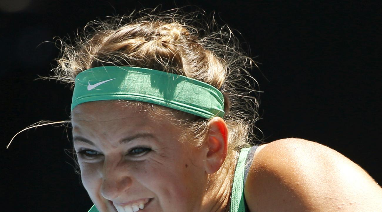 Victoria Azarenka of Belarus makes a backhand return to Barbora Strycova of the Czech Republic during their fourth round match at the Australian Open tennis championships in Melbourne, Australia, Monday, Jan. 25, 2016.(AP Photo/Vincent Thian)