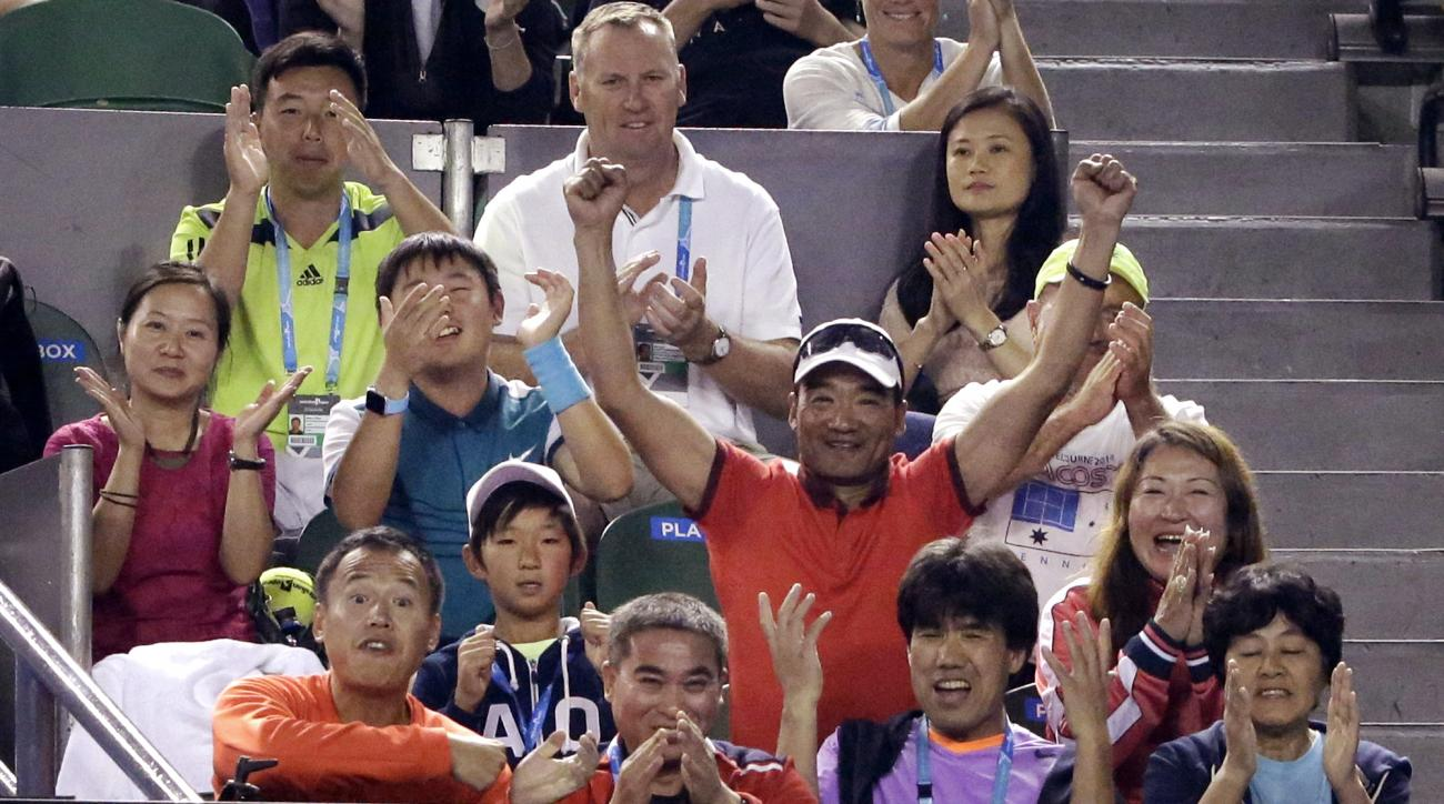 Support staff for Zhang Shuai of China cheer her on from the coaches box during her fourth round match against Madison Keys of the United States at the Australian Open tennis championships in Melbourne, Australia, Monday, Jan. 25, 2016.(AP Photo/Aaron Fav