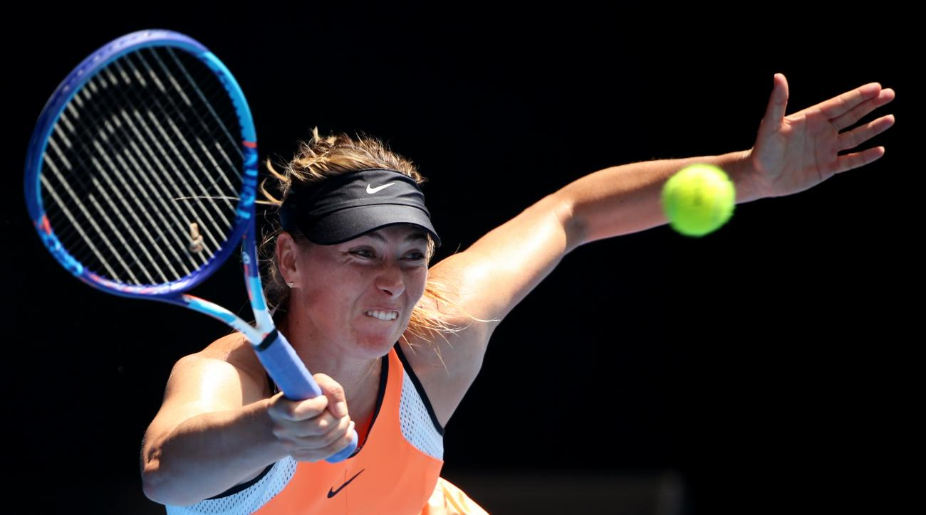 Maria Sharapova of Russia plays a forehand return to Serena Williams of the United States during their quarterfinal match at the Australian Open tennis championships in Melbourne, Australia, Tuesday, Jan. 26, 2016.(AP Photo/Rick Rycroft)