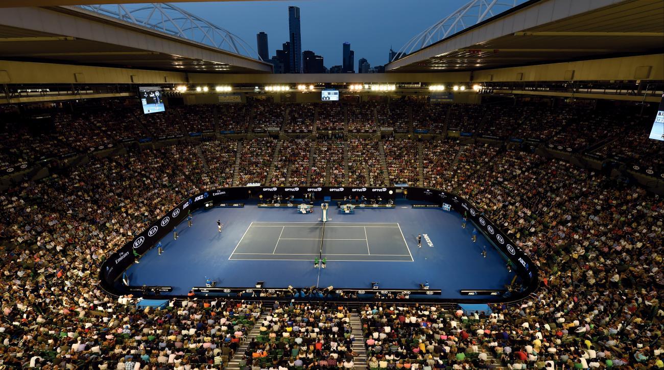 Novak Djokovic, left,  of Serbia plays a return to Kei Nishikori of Japan on Rod Laver Arena during their quarterfinal match at the Australian Open tennis championships in Melbourne, Australia, Tuesday, Jan. 26, 2016.(AP Photo/Andrew Brownbill)