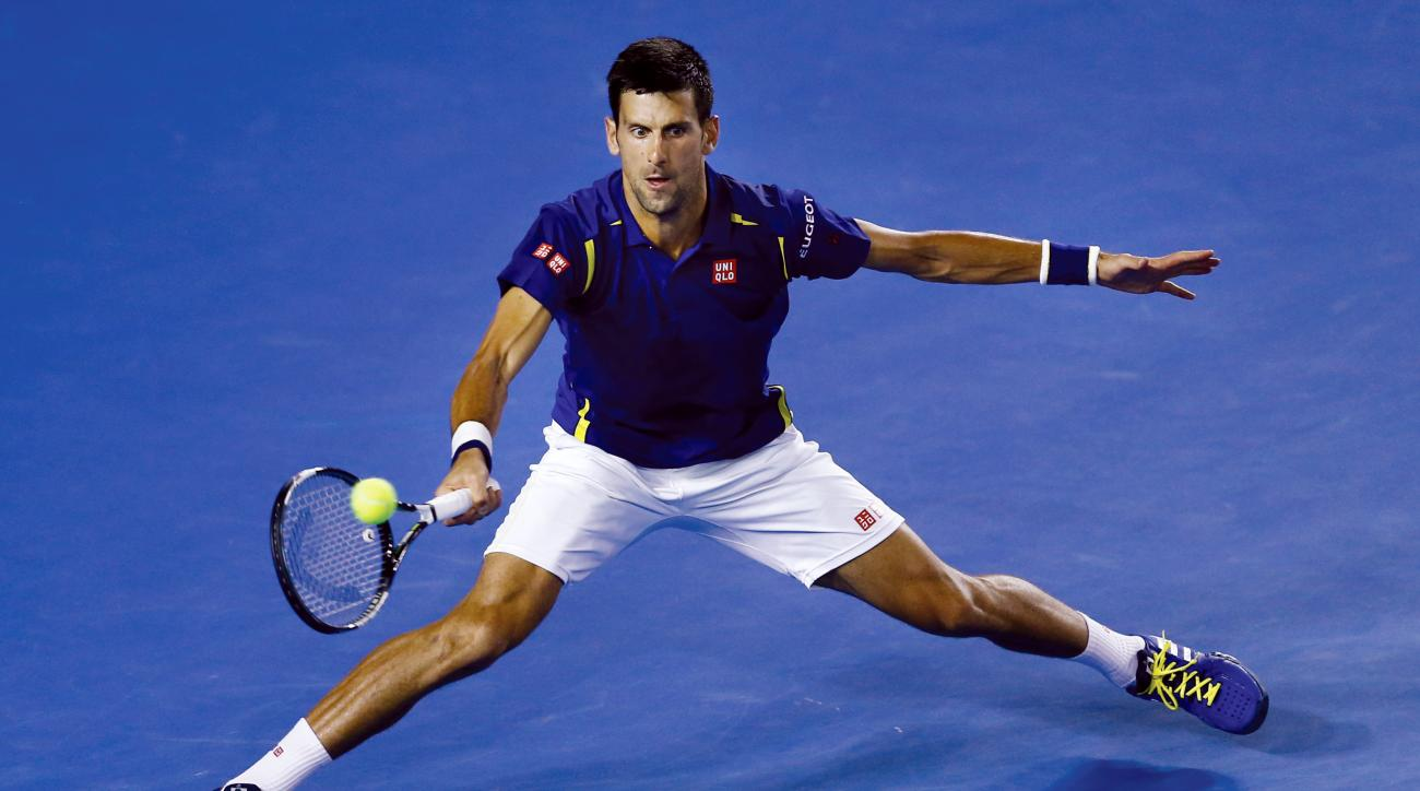 Novak Djokovic of Serbia plays a forehand return to Kei Nishikori of Japan during their quarterfinal match at the Australian Open tennis championships in Melbourne, Australia, Tuesday, Jan. 26, 2016.(AP Photo/Rafiq Maqbool)