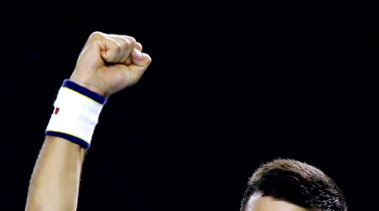 Novak Djokovic of Serbia celebrates after defeating Kei Nishikori of Japan in their quarterfinal match at the Australian Open tennis championships in Melbourne, Australia, Tuesday, Jan. 26, 2016.(AP Photo/Aaron Favila)