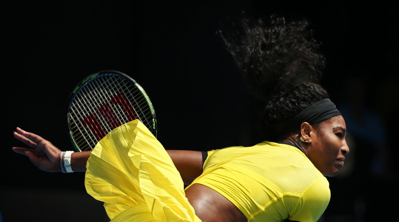 Serena Williams of the United States serves to Maria Sharapova of Russia during their quarterfinal match at the Australian Open tennis championships in Melbourne, Australia, Tuesday, Jan. 26, 2016.(AP Photo/Rick Rycroft)