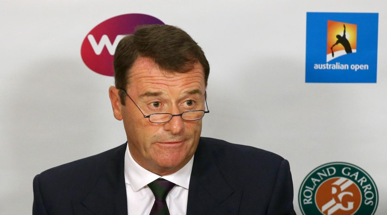 Wimbledon Chairman Philip Brook speaks during a press conference at the Australian Open tennis championships in Melbourne, Australia, Wednesday, Jan. 27, 2016.  Responding to reports that possible evidence of match fixing was not properly investigated, te