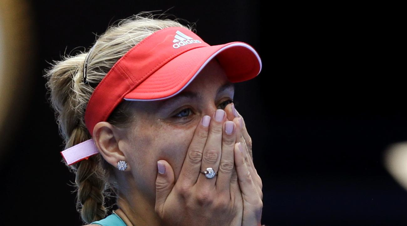 Angelique Kerber of Germany reacts after defeating Victoria Azarenka of Belarus in their quarterfinal match at the Australian Open tennis championships in Melbourne, Australia, Wednesday, Jan. 27, 2016.(AP Photo/Aaron Favila)