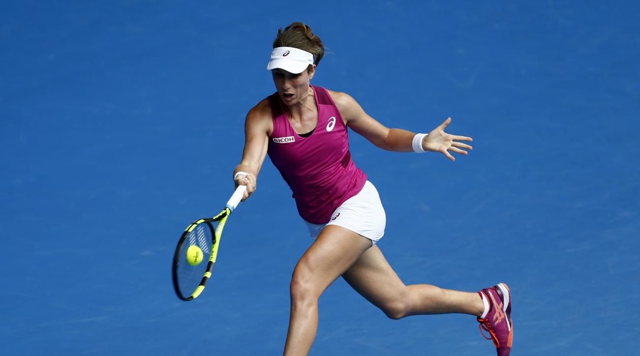 Johanna Konta of Britain makes a forehand return to Zhang Shuai of China during their quarterfinal match at the Australian Open tennis championships in Melbourne, Australia, Wednesday, Jan. 27, 2016.(AP Photo/Rafiq Maqbool)