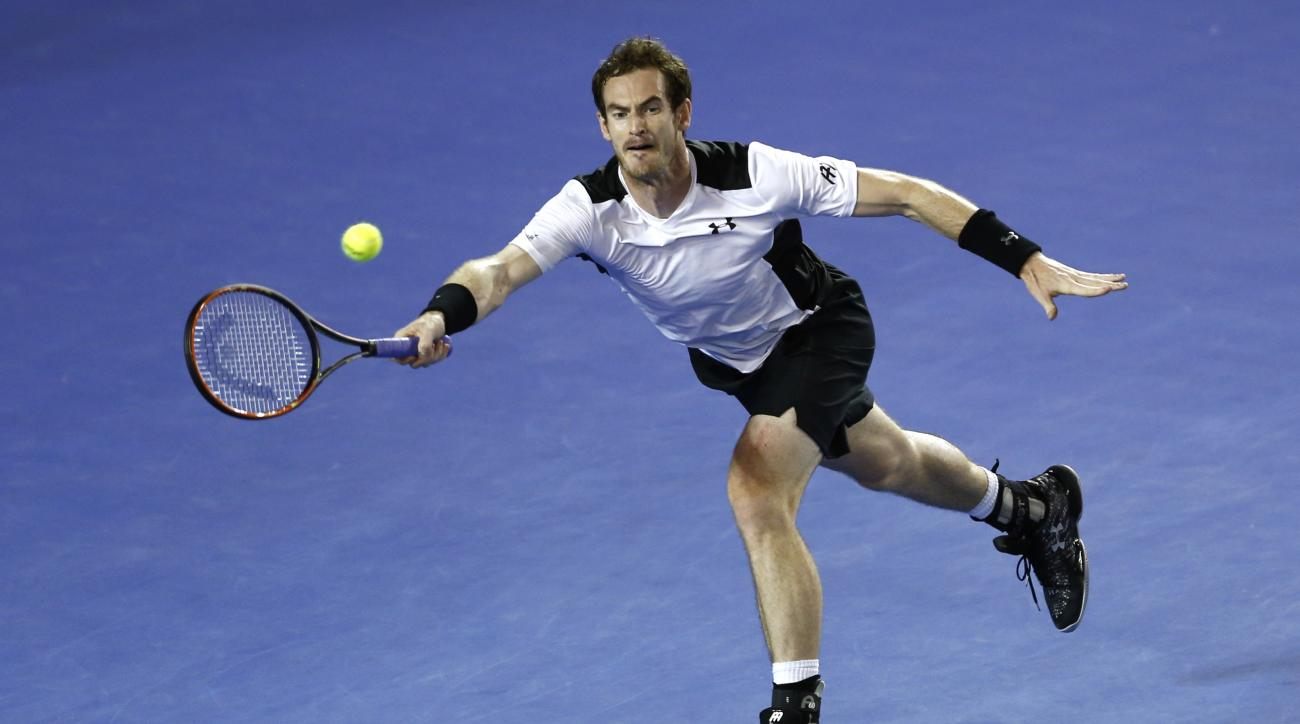 Andy Murray of Britain reaches for a forehand return to David Ferrer of Spain during their quarterfinal match at the Australian Open tennis championships in Melbourne, Australia, Wednesday, Jan. 27, 2016.(AP Photo/Rafiq Maqbool)