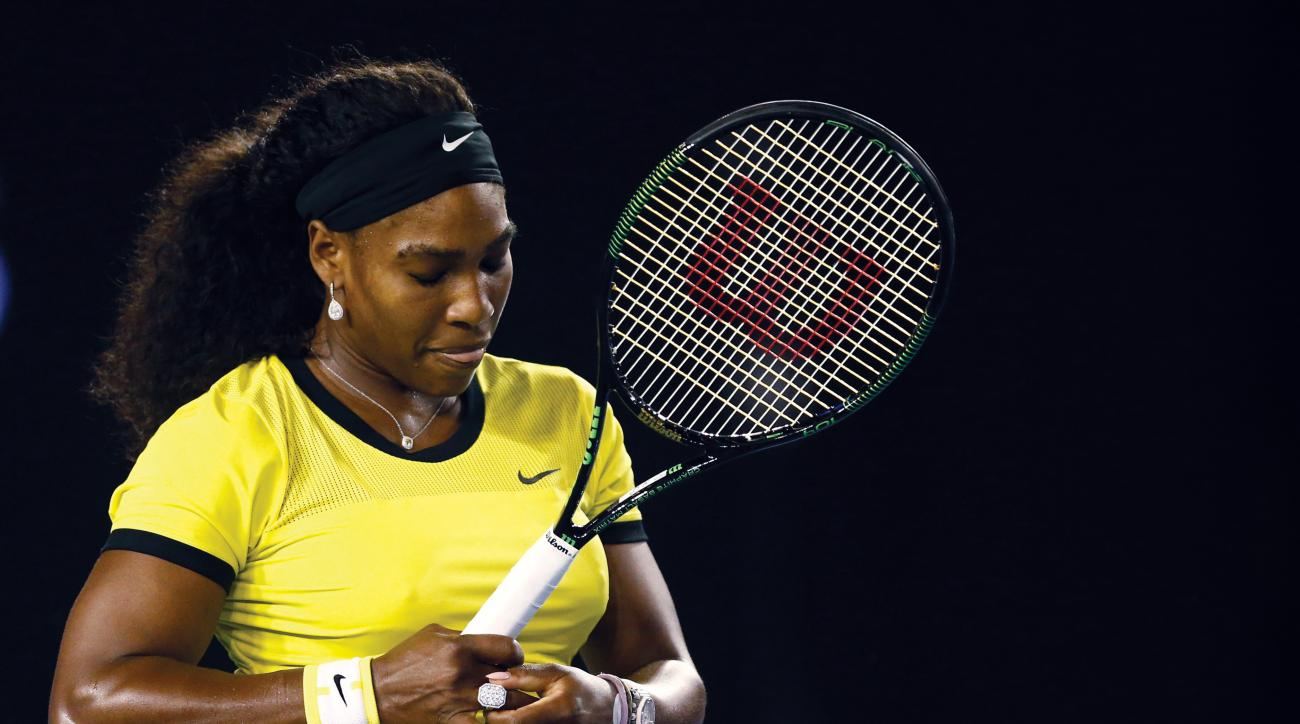 Serena Williams of the United States waits to receive a serve from Agnieszka Radwanska of Poland during their semifinal match at the Australian Open tennis championships in Melbourne, Australia, Thursday, Jan. 28, 2016.(AP Photo/Rafiq Maqbool)