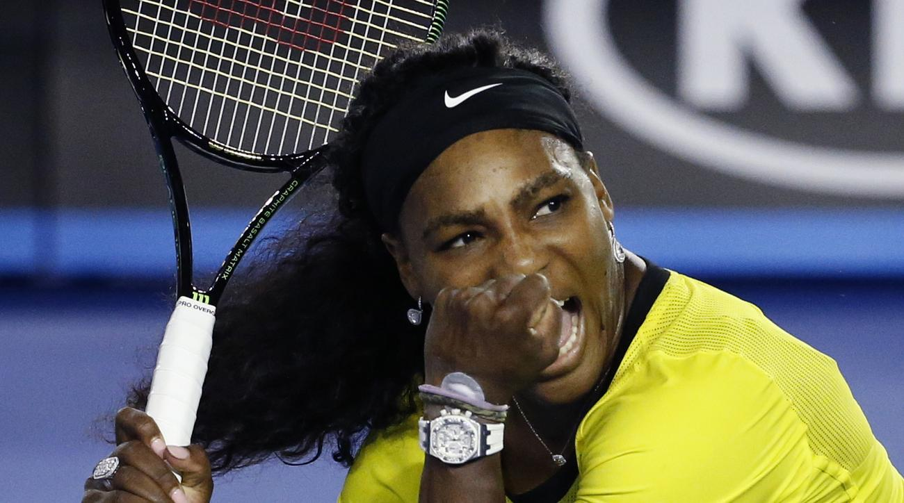 Serena Williams of the United States celebrates after defeating Agnieszka Radwanska of Poland in their semifinal match at the Australian Open tennis championships in Melbourne, Australia, Thursday, Jan. 28, 2016.(AP Photo/Vincent Thian)