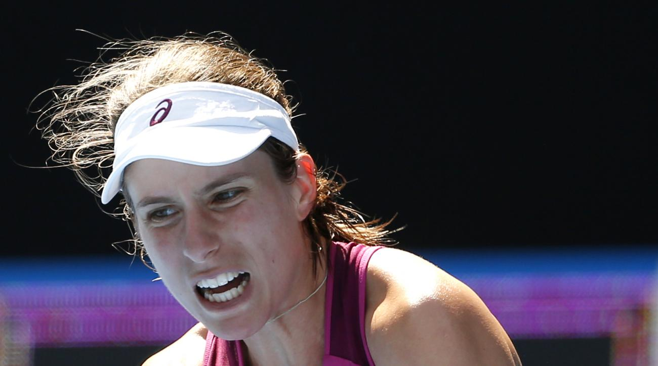 Johanna Konta of Britain plays a backhand return to Angelique Kerber of Germany  during their semifinal match at the Australian Open tennis championships in Melbourne, Australia, Thursday, Jan. 28, 2016.(AP Photo/Vincent Thian)