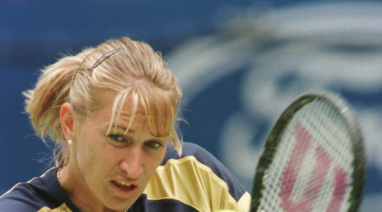 FILE - In this Jan. 21, 1999 file photo, Steffi Graf of Germany returns a shot during her 4-6,6-1,6-2, victory over Barbara Schwartz of Austria at the Australian Open Tennis Championships, Melbourne, Australia. It's been two decades since Steffi Graf won