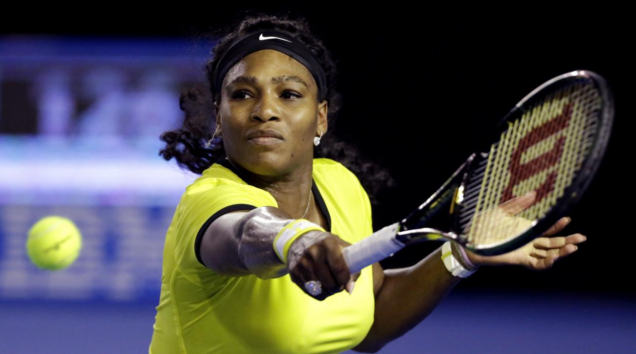 Serena Williams of the United States plays a backhand return to Angelique Kerber of Germanyduring the women's singles final at the Australian Open tennis championships in Melbourne, Australia, Saturday, Jan. 30, 2016.(AP Photo/Aaron Favila)