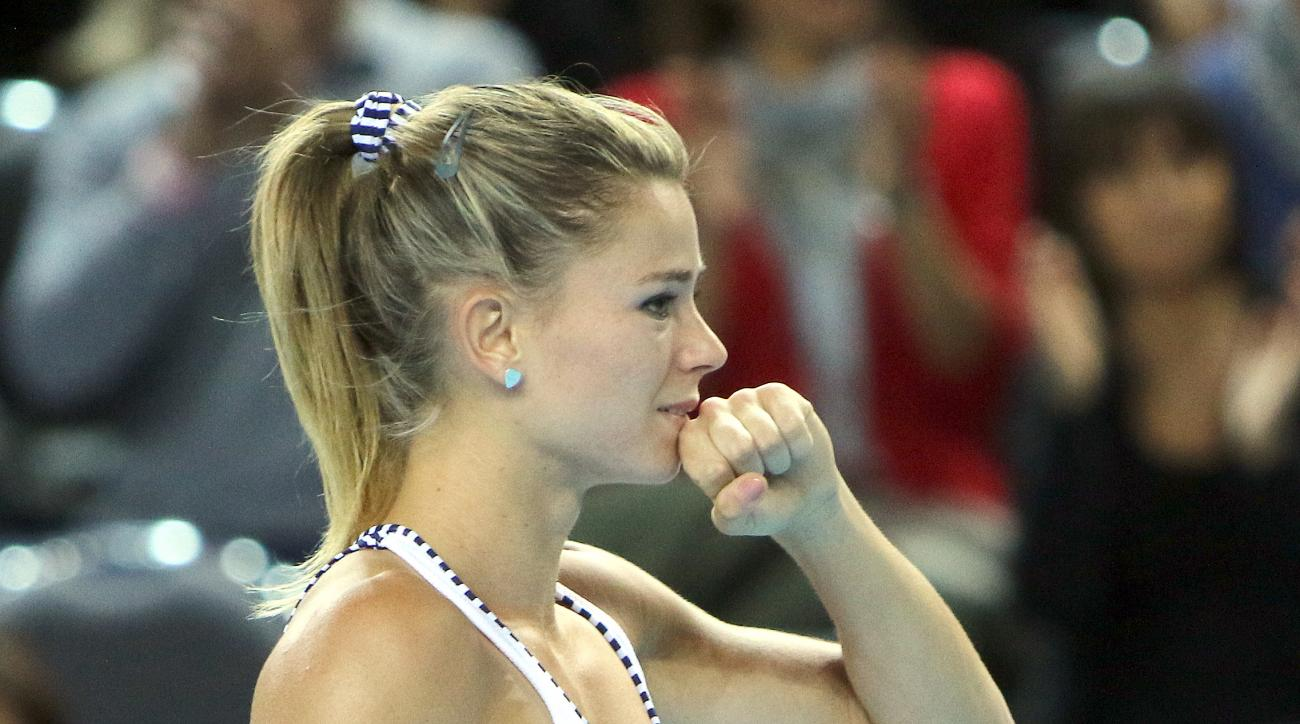 Italy's Camila Giorgi  reacts after defeating France's Kristina Mladenovic during  the first round of the Fed Cup competition between France and Italy, in Marseille, southern France, Saturday, Feb.6, 2016. (AP Photo/Claude Paris)