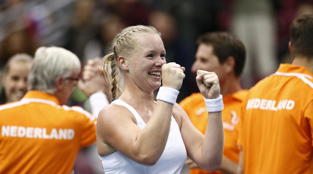 Kiki Bertens of the Netherlands, celebrates her victory over Svetlana Kuznetsova of Russia, during their Fed Cup tennis match between Russia and Netherlands in Moscow, Russia, Sunday, Feb. 7, 2016.  (AP Photo/Alexander Zemlianichenko)