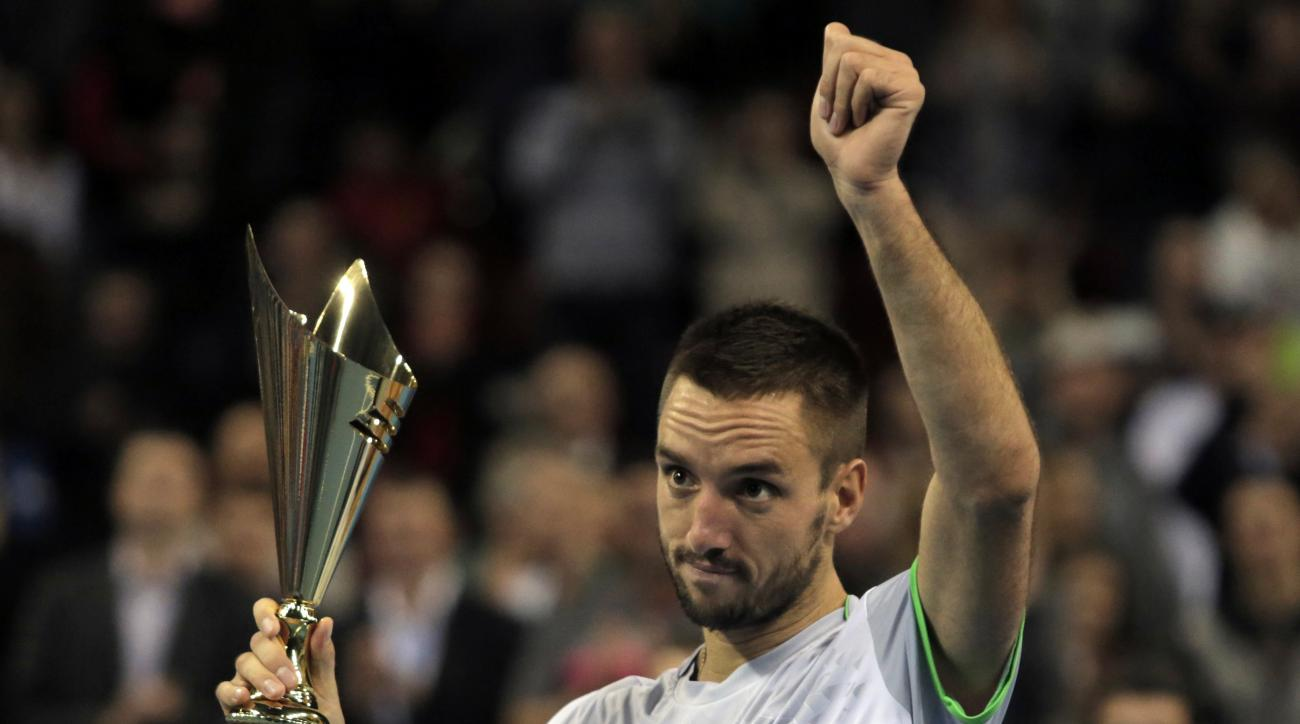 Viktor Troicki of Serbia holds his runners-up trophy after losing to Spain's Roberto Bautista Agut at the final of 2016 Garanti Koza Sofia Open tennis Tournament in Sofia, Bulgaria, Sunday, Feb. 7, 2016. (AP Photo/ Valentina Petrova)