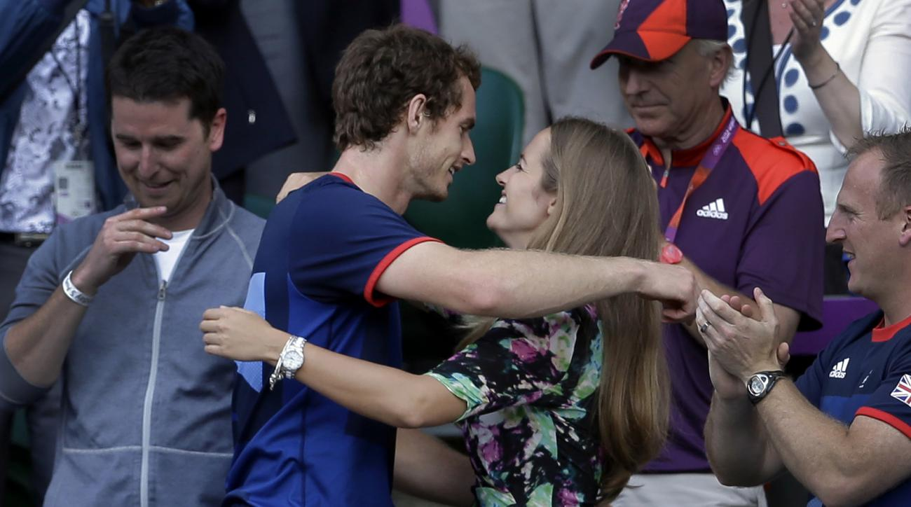 FILE - In this Sunday, Aug. 5, 2012 file photo, Britain's Andy Murray, center left, hugs his girlfriend Kim Sears, after defeating Switzerland's Roger Federer to win the men's singles 2012 Summer Olympics gold medal match, played at the All England Lawn T