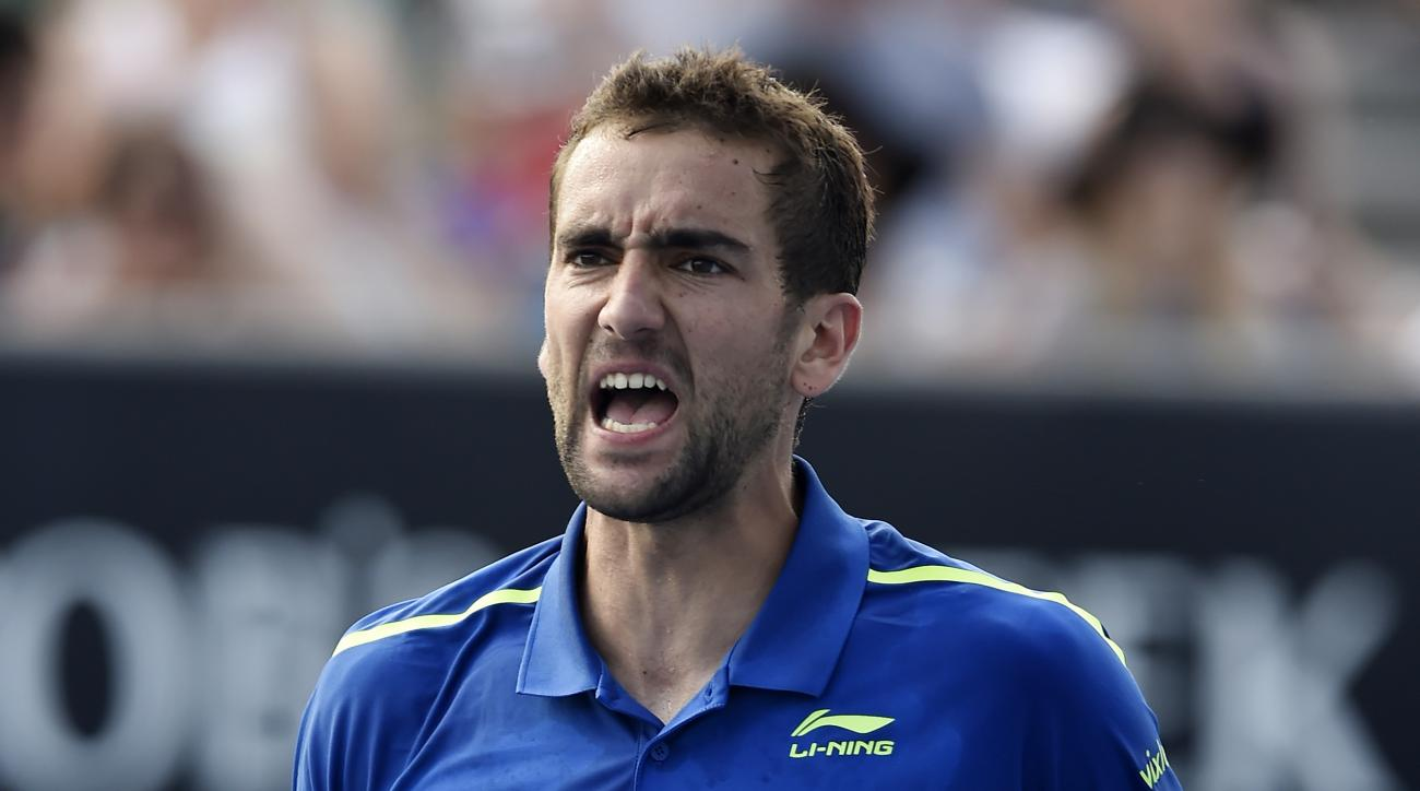 Marin Cilic of Croatia celebrates after defeating Albert Ramos-Vinolas of Spain in their second round match at the Australian Open tennis championships in Melbourne, Australia, Wednesday, Jan. 20, 2016.(AP Photo/Andrew Brownbill)