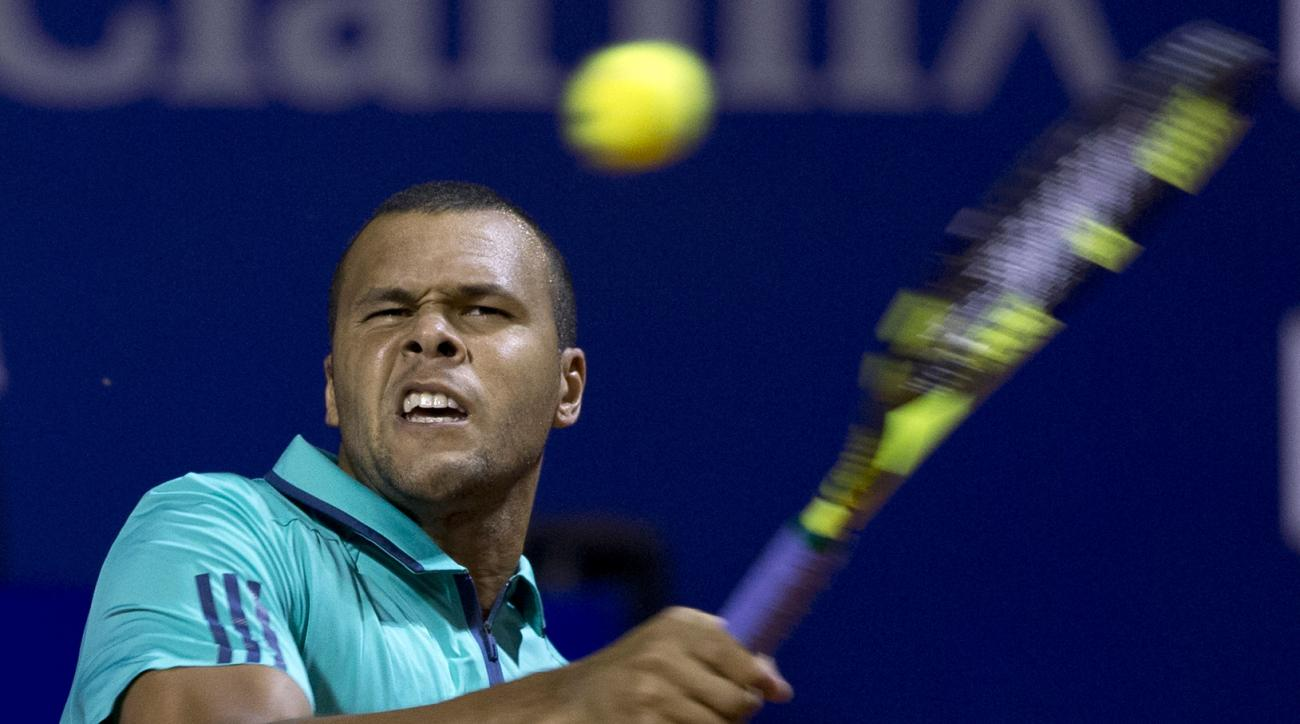 Jo-Wilfried Tsonga of France returns the ball to Leonardo Mayer of Argentina during the ATP Argentina Open in Buenos Aires, Argentina, Wednesday, Feb. 10, 2016. (AP Photo/Natacha Pisarenko)