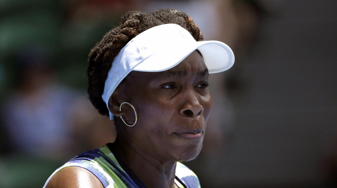 Venus Williams of the United States  plays a forehand return to Johanna Konta of Britain during their first round match at the Australian Open tennis championships in Melbourne, Australia, Tuesday, Jan. 19, 2016.(AP Photo/Aaron Favila)