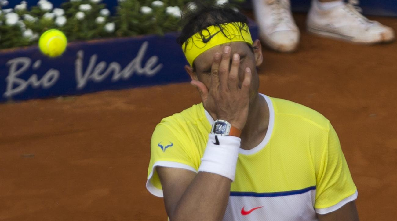 Rafael Nadal of Spain gestures during a tennis match against Dominic Thiem of Austria at the ATP Argentina Open in Buenos Aires, Argentina. Saturday, Feb. 13, 2016. Thiem defeated Nadal 6-4, 4-6, 7-6.  (AP Photo/Ivan Fernandez)