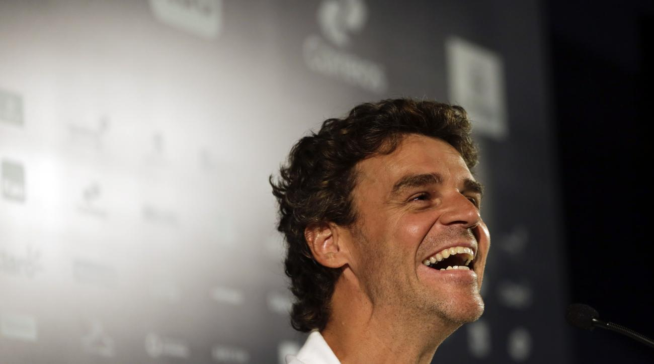 Former Brazilian player Gustavo Kuerten speaks during a press conference at the Rio Open tennis tournament in Rio de Janeiro, Brazil, Monday, Feb. 15, 2016. (AP Photo/Leo Correa)